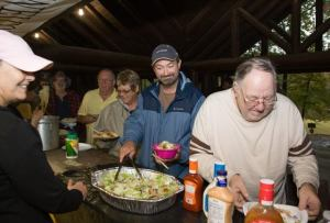 Mr. Hastings, campground host, enjoying the meal