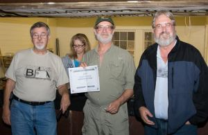 Geore Gehrig receiving his $50.00 gift certificate from Mike with Ouachita Trail Guide